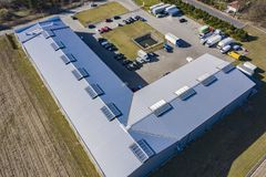 Aerial view of goods warehouse. Logistics center in industrial city zone from above stock image