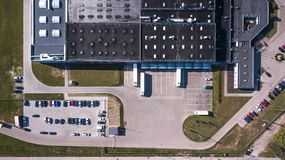 Aerial view of goods warehouse. Logistics center in industrial city zone from above. Aerial view of trucks loading at logistic cen Royalty Free Stock Photography