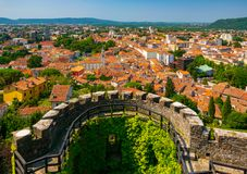 Aerial view of Gorizia city centre and semi-circular bastion of medieval castle, Friuli Venezia Giulia, Italy. At sunny summer day royalty free stock image