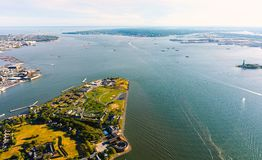Aerial view of the Governors Island, NY with the Statue of Liberty in the background Stock Images
