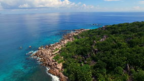 Aerial view of Grand Anse discrict on La Digue island, Seychelles. The tropical paradise of Seychelles Islands from bird's perspective stock footage