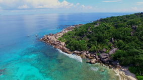 Aerial view of Grand Anse discrict on La Digue island, Seychelles. The tropical paradise of Seychelles Islands from bird's perspective stock video footage
