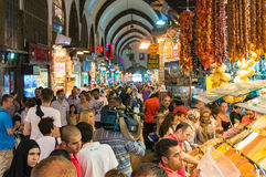 Aerial view of Grand Bazaar interior with locals and tourists. Istanbul, Turkey - August 27, 2013: Aerial view of Grand Bazaar interior with locals and tourists Royalty Free Stock Images