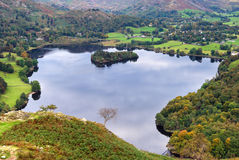 Aerial view of Grasmere in Aut. An aerial view of Grasmere in the English Lake district as seen from the slopes of Loughrigg Stock Image