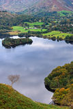 Aerial view of Grasmere in Aut. An aerial view of Grasmere in the English Lake district as seen from the slopes of Loughrigg Stock Photos