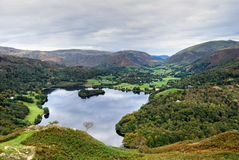 Aerial view of Grasmere & dunm. An aerial view of Grasmere in the English Lake district as seen from the slopes of Loughrigg. Grasmere village & Dunmail Royalty Free Stock Photo