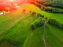Aerial view of grassland, trees and shrubs with a network of sma. Ll paths and hiking trails in spring with fresh green foliage Stock Images