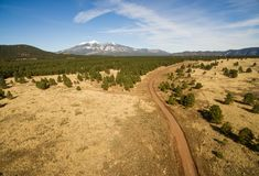 Mount Humphreys Fire Road Coconino National Forest. Aerial view gravel road through the Arizona NF toward the mountain called Humphrey`s Peak Stock Photos