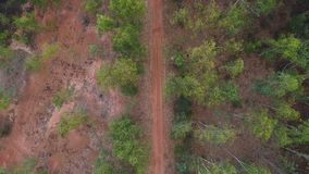 Aerial view of gravel road in rural landscape.  stock footage