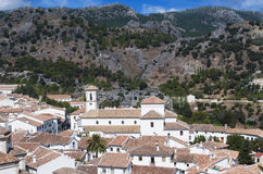 Aerial view of Grazalema. Is located in the Spanish province of Cadiz, a typical rural village of white houses with mountains in the background on a clear day Stock Photography