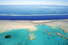 Aerial view of the Great Barrier Reef, Queensland,. The Great Barrier Reef is actually more than 2,800 coral reefs and 900 islands stretching 1,250 miles, with Royalty Free Stock Image