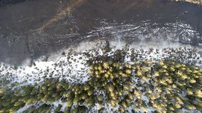 Aerial view of the great lake during spring day with snow stock photos