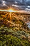 Australia at sunset on a clear winter`s evening in the Northern Territory,. Aerial view of Great Ocean Road coastline at sunset, Australia.The Twelve Apostles, a Stock Image