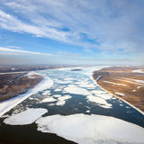 Floating ice floes are drifting on the great river Stock Images