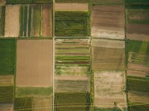 Aerial view of green agricultural fields with power line, europe royalty free stock photography