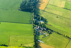 Aerial view of green fields and farm house Royalty Free Stock Image