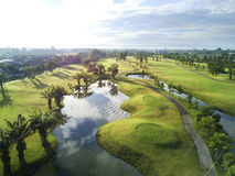 Aerial view of the green golf course in Thailand. Aerial view of the green golf course in Chiang mai, Thailand Royalty Free Stock Photo