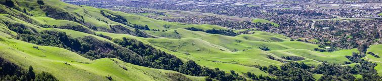 Aerial view of green hills at the base of Mission Peak in south San Francisco bay area. A popular area for hiking, residential areas of Fremont in the royalty free stock photography