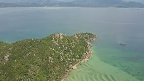 Aerial view green hilly peninsula against Azure ocean stock footage