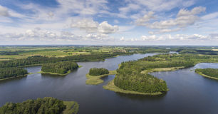 Aerial view of green islands and clouds at summer sunny day.Wydm. Iny lake on Masuria in Poland Stock Photo