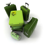 Aerial view of a green luggage kit. Luggage kit in green shades with traveller�s sunglasses and gloves on top Royalty Free Stock Image