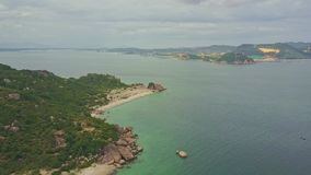 Aerial view rocky coast with sand beach on peninsula stock video footage