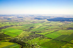 Aerial view of a green rural area Stock Images