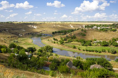 Aerial view of a green rural area under blue sky. Aerial landscape view of a rural area under blue sky. Ghindesti, Moldova Stock Images