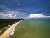 Aerial view Green sea at a brazilian beach coast on a sunny day royalty free stock photos