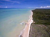 Aerial view Green sea at a brazilian beach coast on a sunny day in Barra do Cahy, Bahia, Brazil. february, 2017. Aerial view Green sea at a brazilian beach royalty free stock image