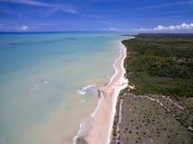 Aerial view Green sea at a brazilian beach coast on a sunny day in Barra do Cahy, Bahia, Brazil. february, 2017. royalty free stock image