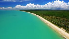 Aerial view Green sea at a brazilian beach coast on a sunny day in Corumbau, Bahia, Brazil. february, 2017. Aerial view Green sea at a brazilian beach coast on stock footage
