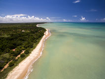 Aerial view Green sea at a brazilian beach coast on a sunny day in Cumuruxatiba, Bahia, Brazil. february, 2017. Aerial view Green sea at a brazilian beach coast stock photos