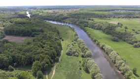Aerial view of the green valley and river stock footage