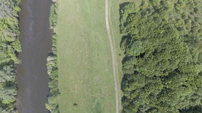 Aerial view of the green valley and river stock video footage