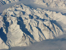 Aerial view of the Greenland mountains. Aerial view of the Greenland with mountains, ocean fields, rocks Stock Image