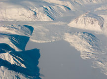 Aerial view of the Greenland snow river. Aerial view of the Greenland with mountain and snow river stock photo
