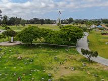 Aerial view of Greenwood Memorial Park with Memorial Statue and American flag. Aerial view of Greenwood Memorial Park & Mortuary. Memorial statue with American stock photos