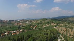 Aerial view of Greve in Chianti Tuscany valley Italy in summer.  stock video footage