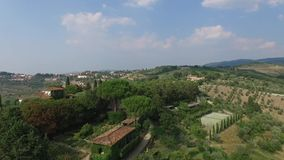 Aerial view of Greve in Chianti Tuscany valley Italy in summer.  stock footage
