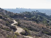 Aerial view of Griffith Observatory and Los Angeles downtown. In a sunny but haze day Stock Images
