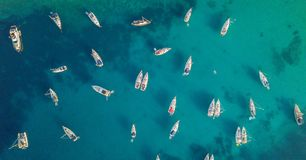 Aerial view of group of sailing boats anchoring on buoys. royalty free stock photo