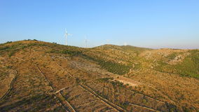 Aerial view of group of windmills on a sunny hill. Aerial view of group of windmills on a sunny Peaceful hill stock video