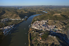 Aerial view of the Guadiana river. As it passes through Sanlucar de Guadiana and Alcoutim Stock Images