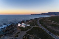 Aerial view of the Guincho area, with the Cabo Raso Lighthouse, the scenic road along the coast and the Roca Cape Cabo da Roca o royalty free stock photography