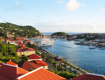 Aerial view at Gustavia Harbor with mega yachts at St Barts. ST BARTS, FRENCH WEST INDIES - JANUARY 12:Aerial view at Gustavia Harbor with mega yachts on January stock photography