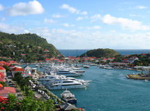 Aerial view at Gustavia Harbor with mega yachts at St. Barts, French West Indies. ST BARTS, FRENCH WEST INDIES - JANUARY 16:Aerial view at Gustavia Harbor with royalty free stock photos