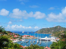 Aerial view at Gustavia Harbor with mega yachts at St Barts, French West Indies. ST BARTS, FRENCH WEST INDIES - JANUARY 19:Aerial view at Gustavia Harbor with royalty free stock images