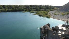 Aerial view of half-submerged prison building in Rummu quarry, Estonia