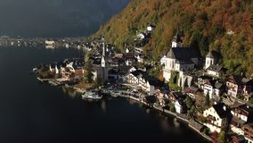 Beautiful landscape of Hallstatt village and Lake Hallstatt in Austria. Aerial view of Hallstatt village and Lake Hallstatt with blue sky in Austria stock video